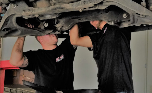 South Valley Automotive technicians working on the underside of a vehicle